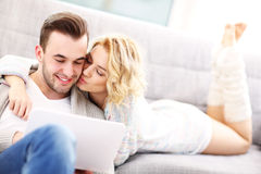 romantic-couple-laptop-living-room-picture-53392965
